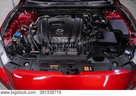 Novosibirsk, Russia - October 16, 2020: Mazda 3, Car Engine Close-up. Internal Combustion Engine, Ca