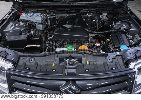 Novosibirsk, Russia - October 16, 2020: Suzuki Grand Vitara , Car Engine Close-up. Internal Combusti