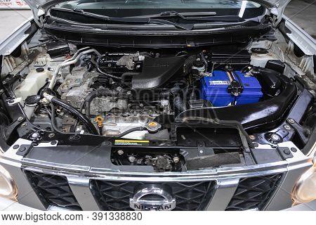 Novosibirsk, Russia - October 16, 2020: Nissan X-trail, Car Engine Close-up. Internal Combustion Eng