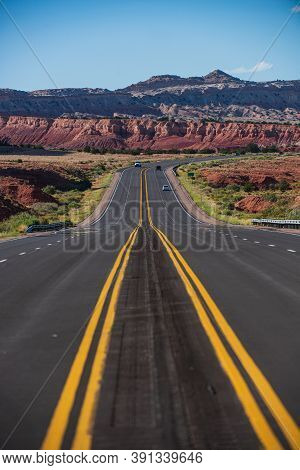 Highway Road Running Through The Barren Scenery Of The American Southwest With Extreme Heat Haze On