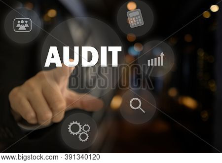 Businessman Pointing The Text Audit Button On Virtual Screens. The Concept Of The Internal Audit, Au