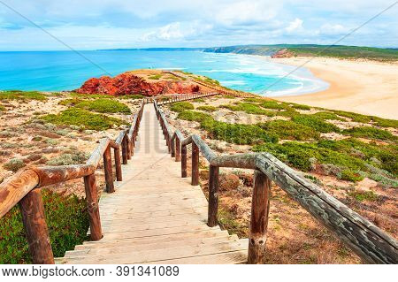Beautiful Shore Of Atlantic Ocean And Stairs To The Beach. Algarve, Portugal. Famous Travel Destinat