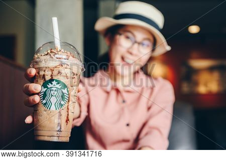 Chiang Mai, Thailand : 22/07/2020 : Tourist Woman Holding A Cup Of Choco-choco Nutty Frappuccino In