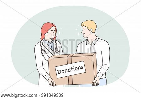 Medicine, Health, Volunteering, Help, Donation Concept. Young Man And Woman Doctor Volunteers Holdin