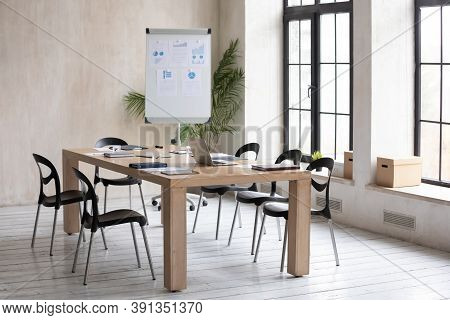 Empty Modern Office With Whiteboard And Table