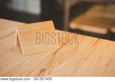 Empty Wooden Tag For Reserved Restaurant. Concept Of Reserved Table. A Tag Of Reservation