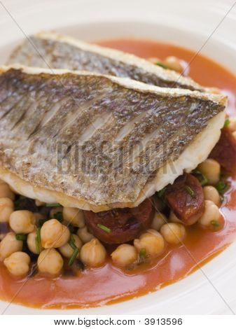 Fillets Of Sea Bream With Chorizo Sausage Chickpeas And Tomato Sauce