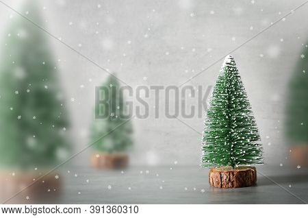 Minimalistic Christmas Composition With Decorative Fir Tree, Wooden Sledge , Snow On Grey Background