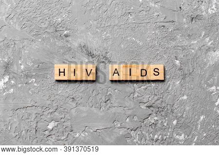 Hiv Aids Word Written On Wood Block. Hiv Aids Text On Cement Table For Your Desing, Concept