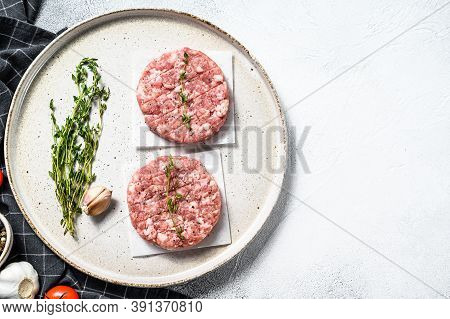 Raw Chicken Cutlets, Ground Meat Patty. Organic Mince. White Background. Top View. Copy Space