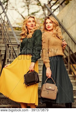 Vogue Concept. Girls Blonde Wear Matching Clothes. Matching Outfits. Women Sisters Outdoors Stairs B