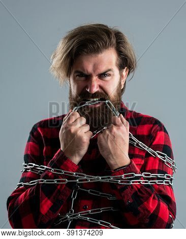 I Want To Be Free. Healthy Teeth. Brutal Man With Chain. Chained Up In Chains. Bearded Man Has Aggre