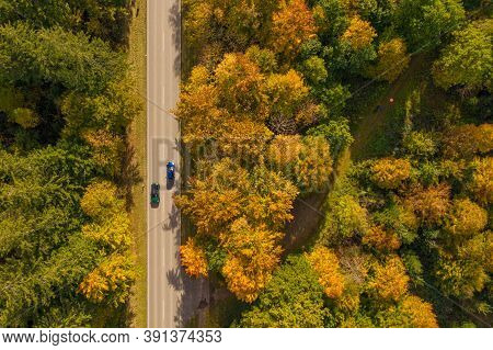 Autumn Colors Of Fall Trees Besides A Straight Road With Two Oncoming Cars, Photography Straight Fro