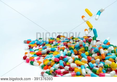 Selective Focus On Pile Of Antibiotic Capsule Pills. Colorful Antibiotic Capsules Pill Falling On Wh