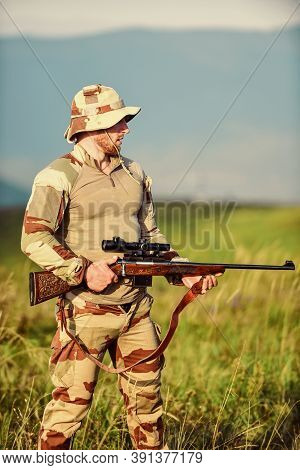 Brutal Warrior. Rifle For Hunting. Army Forces. Man Military Clothes With Weapon. Ready To Shoot. Fo