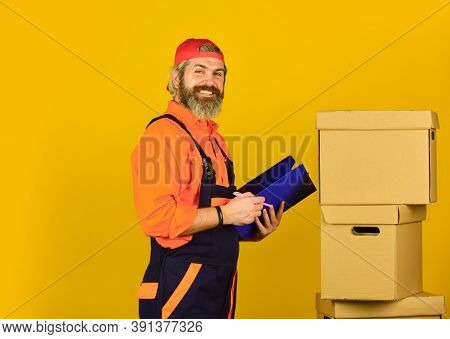 Insurance Agent. Moving To New Apartment. Post Service. Bearded Loader In Uniform. Moving Day. Renov
