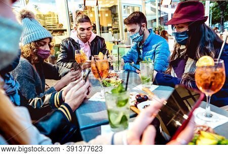 Millenial People Using Mobile Smart Phones At Cocktail Bar - New Normal Lifestyle Concept With Frien