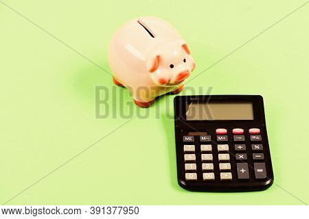 Devastation. Moneybox With Calculator. Piggy Bank. Money Saving. Accounting And Payroll. Bookkeeping