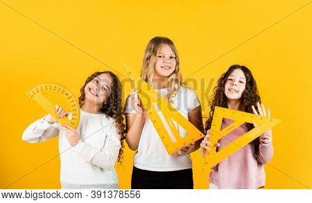 Modern Education Concept. Sisterhood. Three Girls With Protractor And Triangle Ruler. Back To School