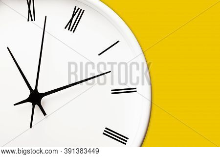 White Round Clock With Black Arrows And Numbers On Yellow Wall. Time Symbol Background. Hours And Mi