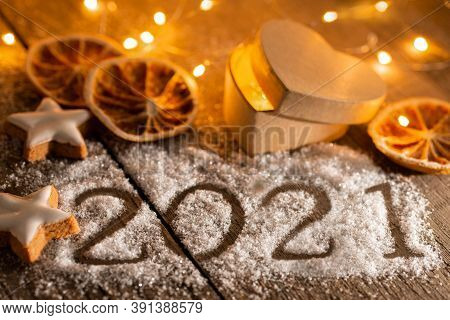 Christmas And New Year's Greetings 2021 - Year Number With Cinnamon Stars, Spices And Lights On Wood