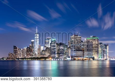 New York City midtown Manhattan cityscape on the East River at twilight.