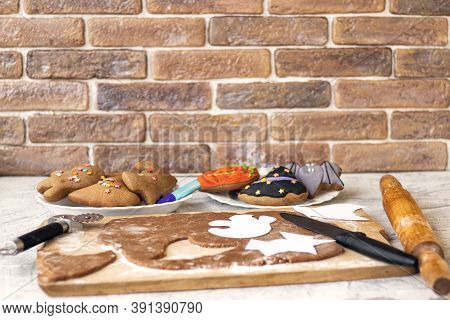 Making Homemade Gingerbread Cookies For Halloween On Brick Wall Background.preparation For Halloween