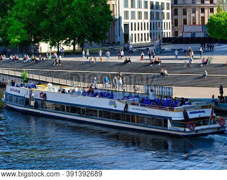 Berlin, Germany - July 26th, 2020 - An Excursion Boat - Named Schöneberg - With Tourists On The Rive