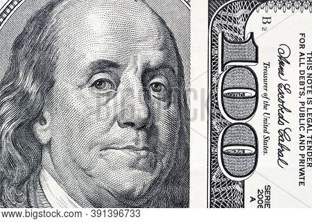 Benjamin Franklin\'s Eyes From A Hundred-dollar Bill. The Eyes Of Benjamin Franklin On The Hundred D