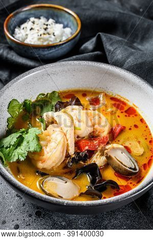 Tom Yam Kong Or Tom Yum, Clear Soup.tom Yam. Black Background. Top View