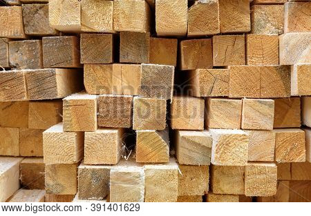 Lumber In Sawmill, Ends Of Timber Blocks For Texture Background. Sawed And Processed Wood In Warehou