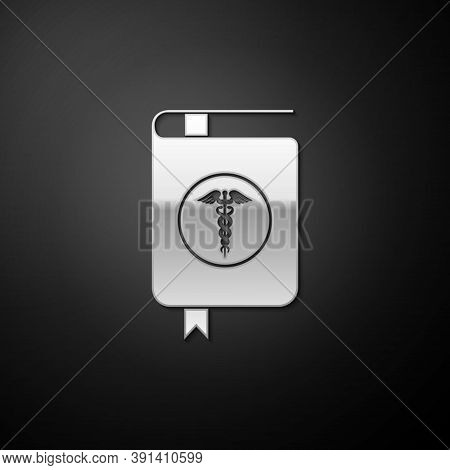 Silver Medical Book And Caduceus Medical Icon Isolated On Black Background. Medical Reference Book,