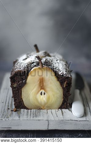 Chocolate Pie With Pears And Nuts On A Board