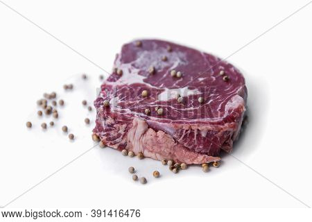 Tenderloin And Pepper On A White Background