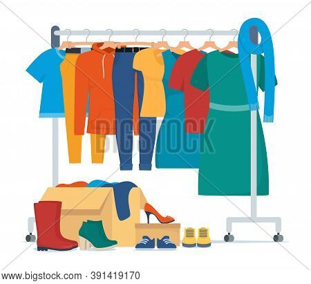Clothes For Donation. Various Clothes On A Hanger And In Boxes, Shoes. Cheap And Free Seasonal Garme