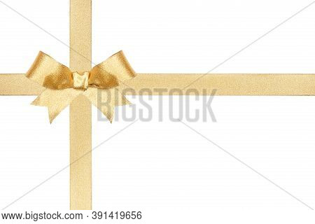 Shiny Gold Christmas Gift Bow And Ribbon Arranged As Wrapped Gift Box Isolated On A White Background