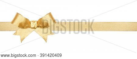 Shiny Gold Christmas Gift Bow And Ribbon. Long Border Isolated On A White Background.