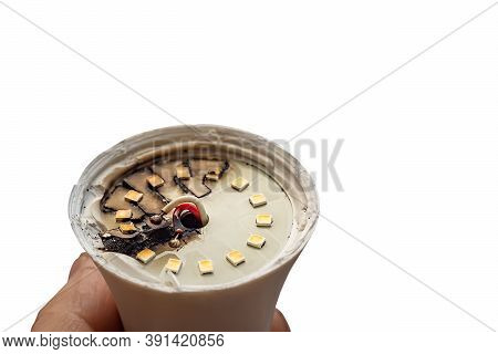 Burned Out, Faulty, Blackened Led Light Bulb In A Person Hand, Isolated On A White Background
