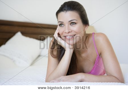 Middle Eastern Woman At Home Laying On Bed