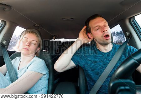 Couple Of People Fall Asleep Driving Car. Danger Of Tired Driver Falling Asleep On Road.