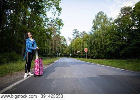 A Young Girl Stops By Hitchhiking To Shorten The Travel Time To The Arranged One. A Hot Day Can Be F