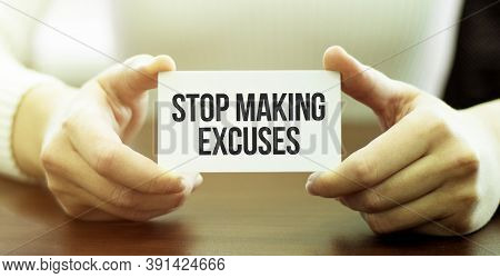 Businessman Holding A Card With Text Stop Making Excuses