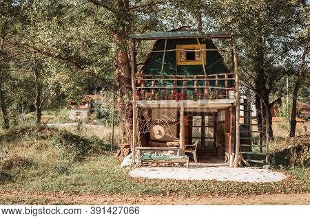 Small Colorful Handmade Cabin In The Countryside