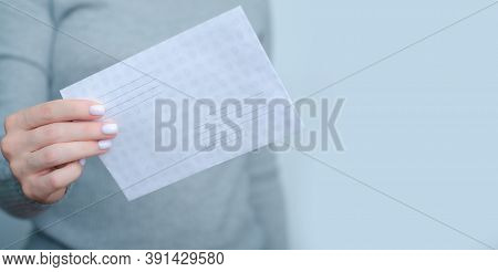 Woman Holding Postal Envelope In Hand On Gray Background