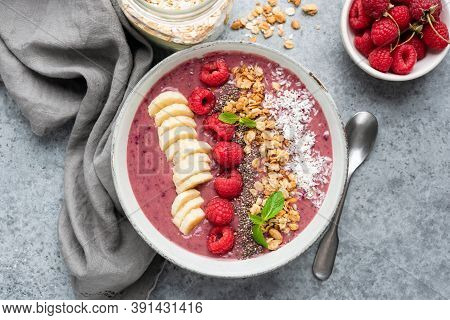 Tasty Pink Superfood Smoothie Bowl On Grey Concrete Background. Healthy Vegan Vegetarian Raspberry S