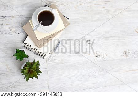 Desk Office With Blank Notepad, Coffee Cup And Pen On Wood Table. Flat Lay Top View Copy Space. Top