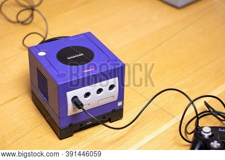 An Indigo Original Gamecube Console, A Popular Retro Console On A Wood Floor.