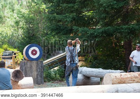 Prospect, Oregon / Usa - August 16, 2014: A Man Prepares To Throw An Axe At A Target During A Compet