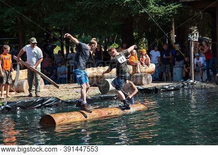 Prospect, Oregon / Usa - August 16, 2014: Two Men Compete In The Log Rolling Skill Event At The Pros