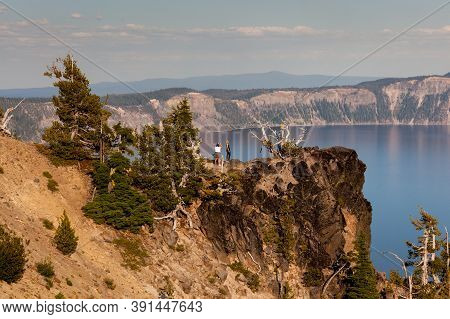 Crater Lake National Park, Oregon / Usa - September 6, 2014:  Tourists Take Pictures On A Narrow Cli